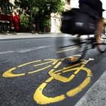 Újabb fejkamerás videó: így szorítja le a bringást egy Honda
