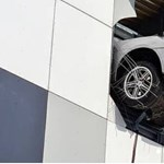 A Russian ice hockey Porsche crashes from the third floor of a parking garage