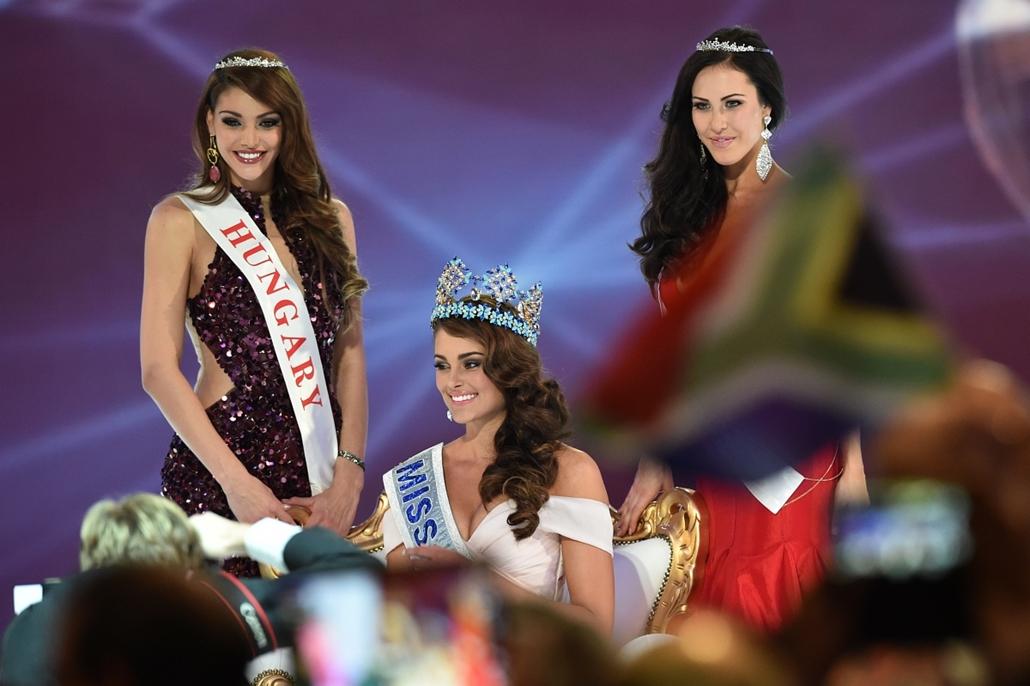 afp. Miss Hungary, 2014.12.14. London, Miss World szépségverseny Nagy-Britanniában, A 2014-as Miss World nemzetközi szépségverseny győztesének választott dél-afrikai Rolene Strauss (k), a második helyezett Kulcsár Edina, Magyarország Szépe (b) és a harmad