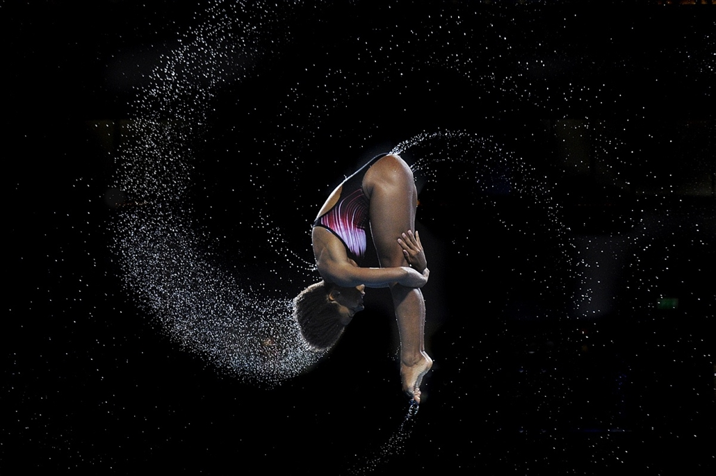 afp. az év sportfotói 2014. Edinburgh, Egyesült Királyság, 2014.08.01. Jennifer Abel of Canada competes to win the gold medal in the Women's 1m Springboard final diving competition at the Royal Commonwealth Pool during the 2014 Commonwealth Games in Edinb