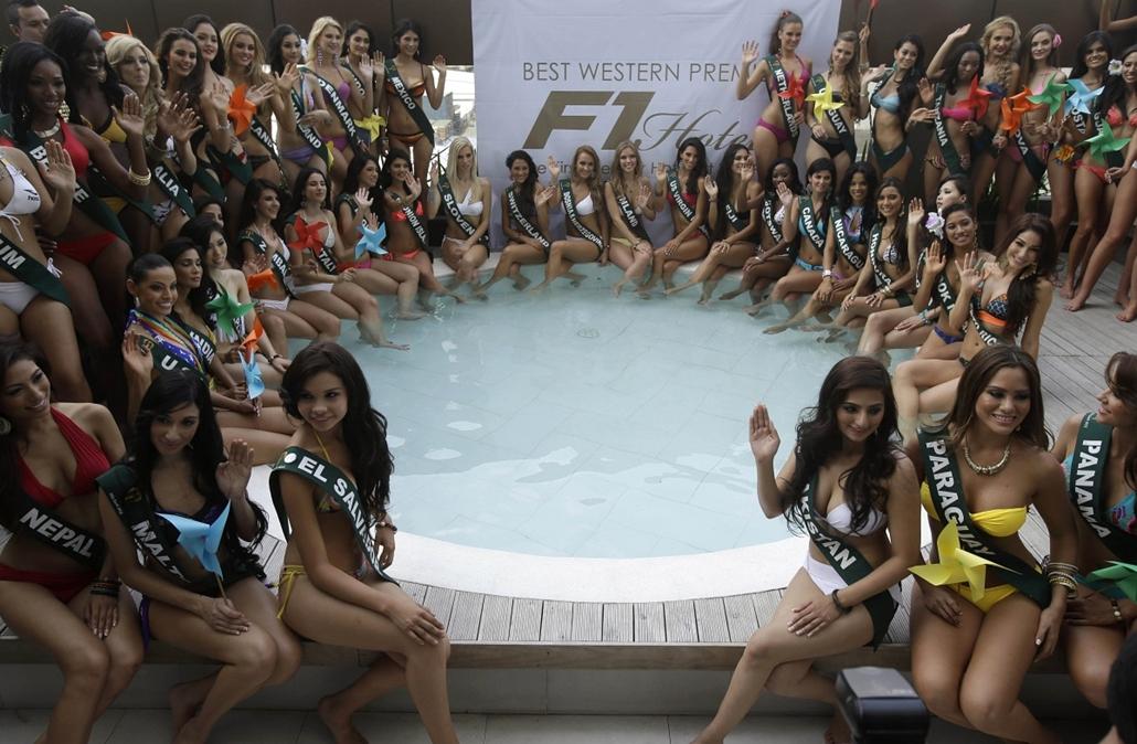 AP. Taguig, Fülöp-szigetek: Az idei Miss Earth szépségverseny indulóinak pózolása - hét képei nagyítás