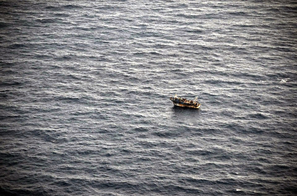 afp. hajóval érkező menekültek, migránsok, - 2014.03.31. A handout picture released by the Hellenic Coast Guard on April 1, 2014 and taken on March 31, 2014 shows immigrants on a boat at sea off the Greek island of Crete. Greek Coast Guard authorities mou